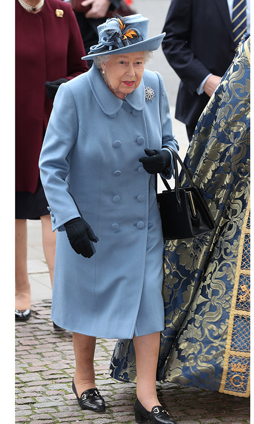 <a href=/tags/0/queen-elizabeth-ii><strong>The Queen</strong></a> looked lovely at the Commonwealth Day service in a pale blue coat and matching hat. The fascinator featured a brilliant pop of orange.