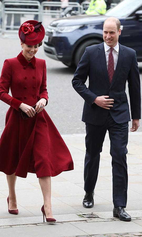 <a href=/tags/0/kate-middleton><strong>Duchess Kate</strong></a> and <a href=/tags/0/prince-william><strong>Prince William</strong></a> stepped out to Westminster Abbey, too. The mom of three sported a crimson <a href=/tags/0/catherine-walker><strong>Catherine Walker</strong></a> coat with coordinating <strong>Sally-Ann Provan</strong> floral hat, heels and diamond and ruby floral earrings.