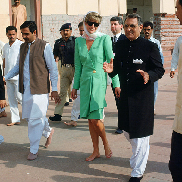 <a href=/tags/0/princess-diana><strong>Princess Diana</strong></a> cut an elegant figure in a tailored Kelly green skirt suit and white headscarf while visiting Badshahi Mosque in Lahore, Pakistan in Sept. 1991.