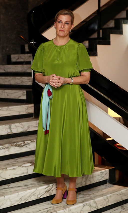 <a href=/tags/0/countess-of-wessex><strong>Sophie, Countess of Wessex</strong></a> wowed in a vivacious green dress from <strong>A Ross Girl</strong> with contrasting sash and ochre <a href=/tags/0/penelope-chilvers><strong>Penelope Chilvers</strong></a> heels at a reception for UK partners in Sierra Leone at the British High Commissioner's residence in Freetown on Jan. 22, 2020.<p>Photo: &copy; Jonathan Brady/PA Images via Getty Images