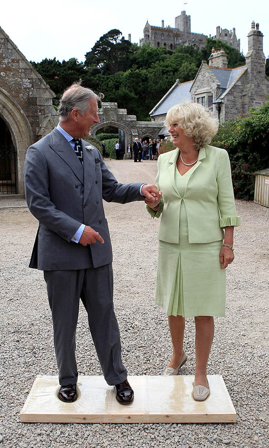 The <a href=/tags/0/camilla-parker-bowles><strong>Duchess of Cornwall</strong></a> was so chic in a pastel green skirt suit as she and <a href=/tags/0/prince-charles><strong>Prince Charles</strong></a> made imprints of their feet for a cast at St. Michael's Mount on July 12, 2010 in Marazion.