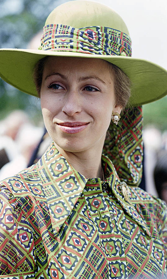 A young <a href=/tags/0/princess-anne><strong>Princess Anne</strong></a> showcased her flair for fashion at a village fete in Great Somerford, Gloucestershire on June 21, 1975. She wore a lime green patterned blouse with matching hat and scarf.