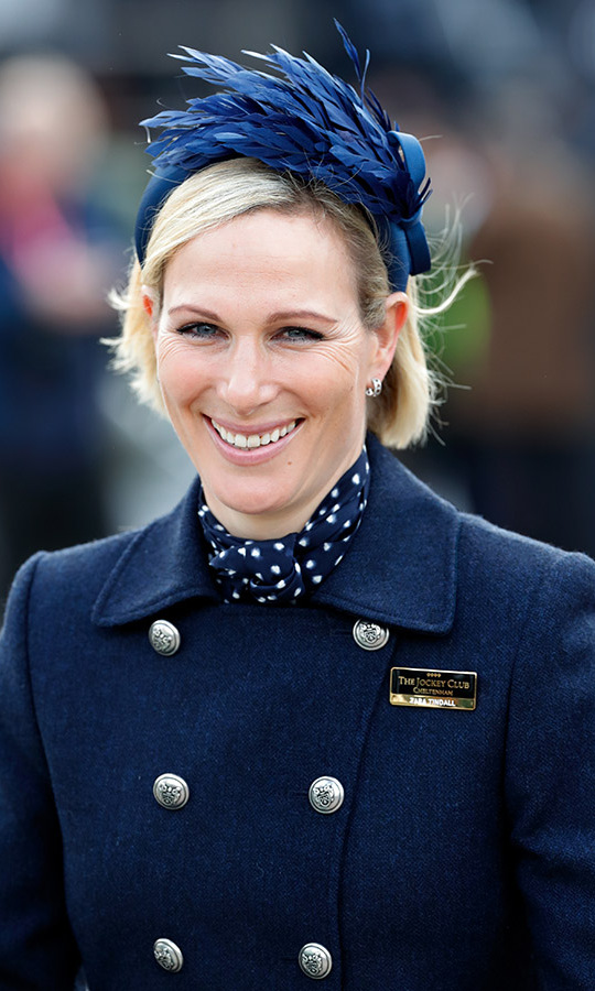 <a href=/tags/0/zara-tindall><strong>Zara Tindall</strong></a> complemented her monochromatic navy ensemble with a feathered fascinator at the races on March 10.