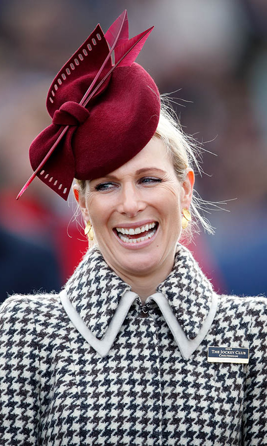 <a href=/tags/0/zara-tindall><strong>Zara Tindall</strong></a> made another style statement on Ladies Day in a bespoke black-and-white houndstooth coat by <strong>Laura Green London</strong> topped with a dramatic ruby red fascinator by <strong>Juliette Botterill</strong>.