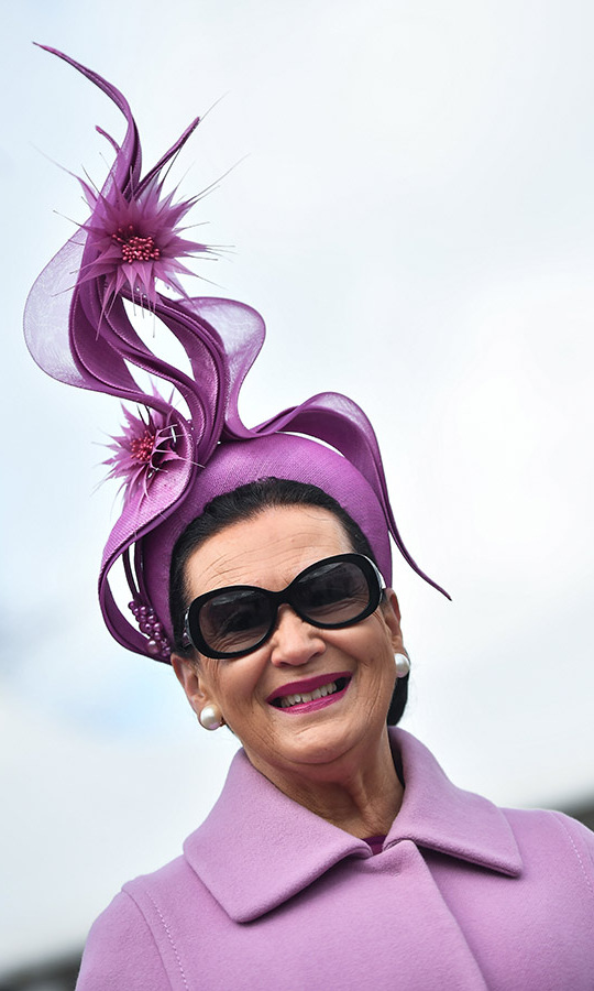 There was no missing this gravity-defying hat with its sculptural design and spiky flower accents. It was the perfect finishing touch to the all-purple ensemble.