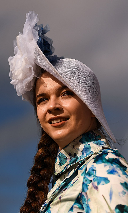 Ladies Day at the Cheltenham Racing Festival brought out a multitude of incredible fascinators, including this bold number. The fashionable wide-brimmed hat was accented with flower-like tufts of fabric.