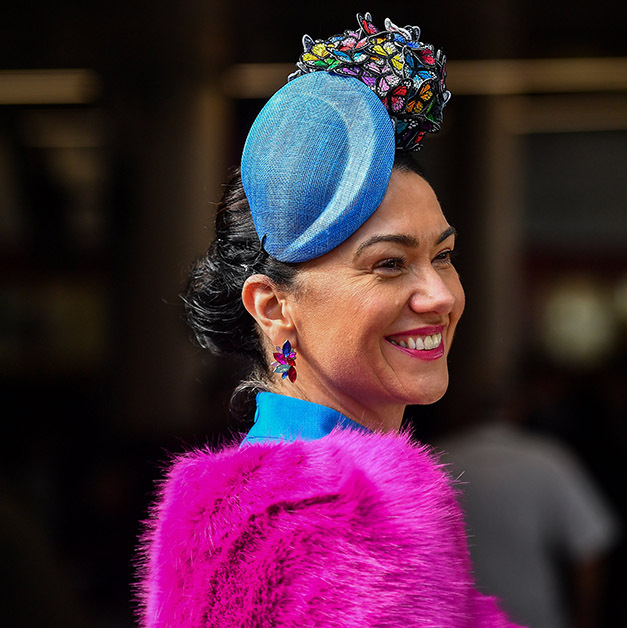 A Cheltenham Festival attendee was a vision in an array of colours. Her hot pink furry coat was accented with a blue fascinator complete with a cluster of multicoloured butterflies! 