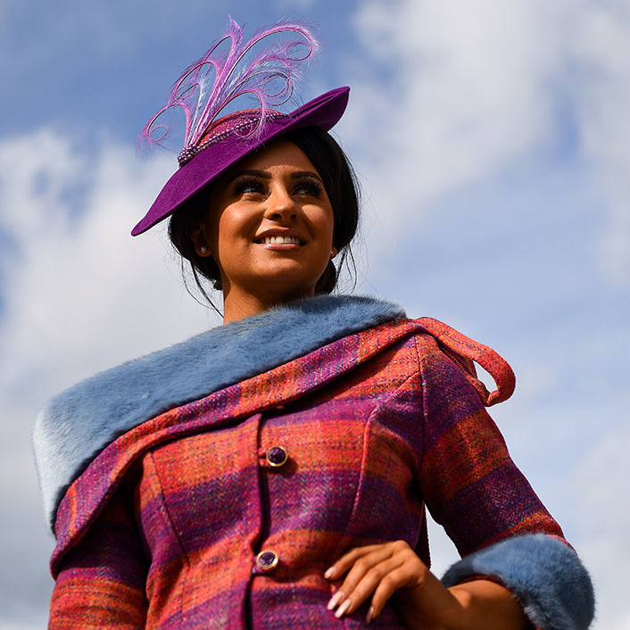 On the second day of the Cheltenham Festival, a stylish attendee showed off her striped tweed suit and feathered fascinator. The hat was tipped at a jaunty angle.