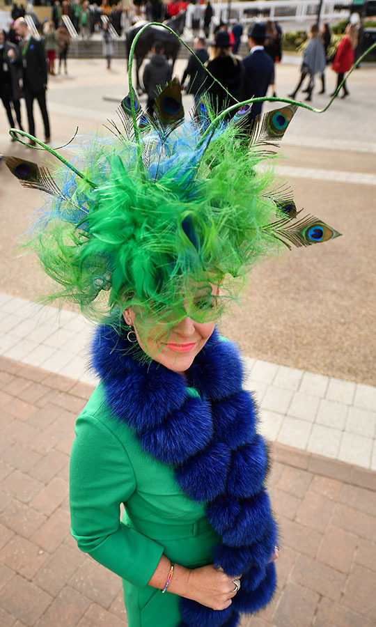 This attendee certainly dressed to the St. Patrick's Day theme of the third day of the Cheltenham Racing Festival thanks to this extravagant green and blue hat accented with peacock feathers.