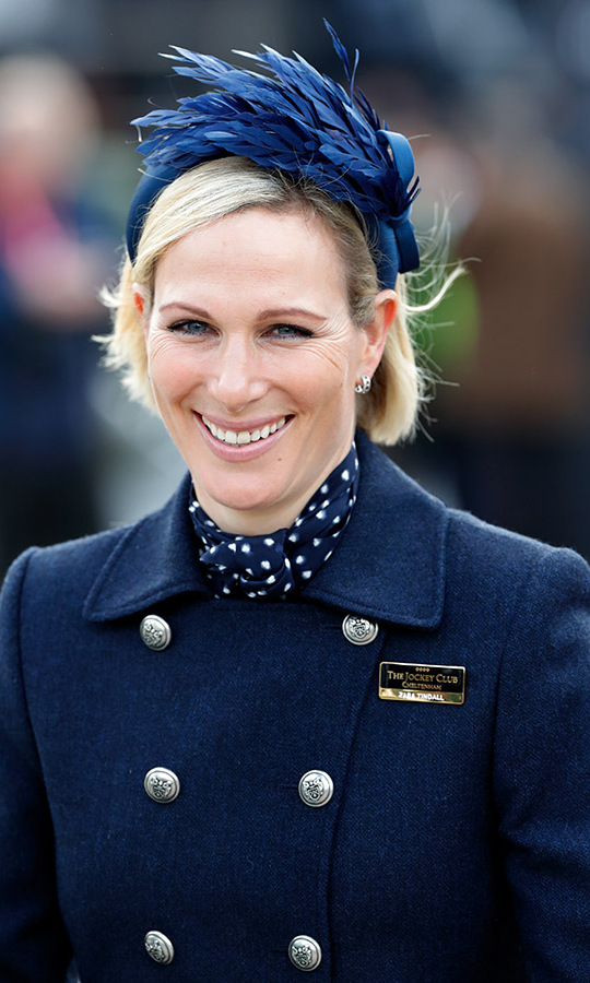 On March 10, <a href=/tags/0/zara-tindall><strong>Zara Tindall</strong></a> stepped out to the Cheltenham Festival 2020 in a monochromatic navy outfit featuring a polka dot underlayer and feathered fascinator.