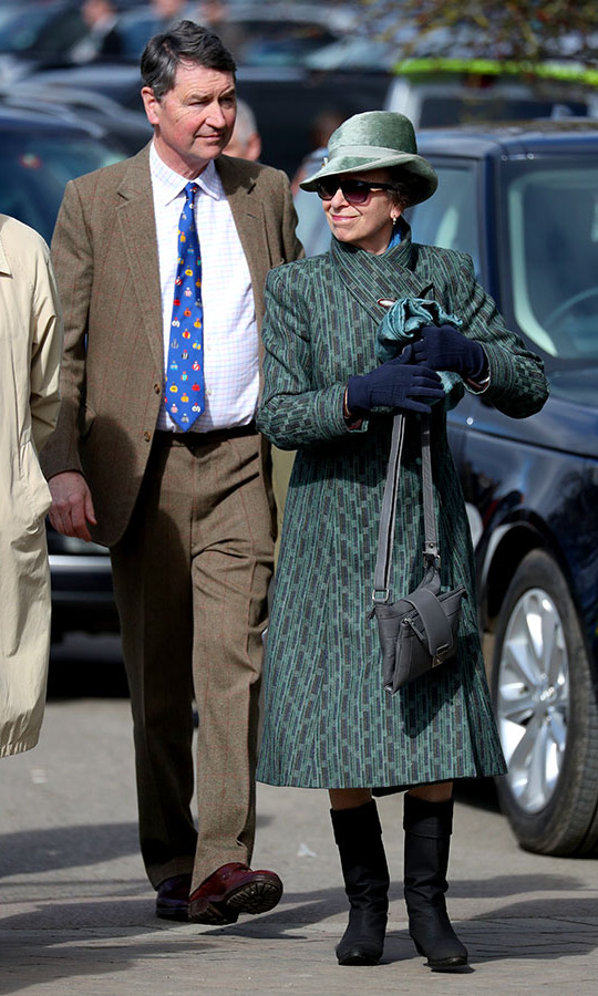 Also at the races on March 13, <a href=/tags/0/princess-anne><strong>Princess Anne</strong></a> put on a coordinated display in a brown-and-teal printed coat with dark accessories and a mint green velvet fedora.