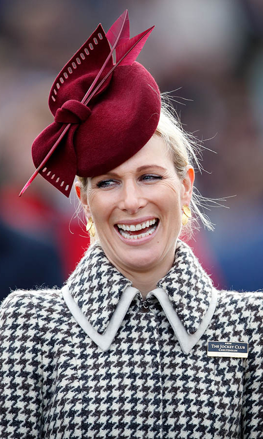 On March 11, <a href=/tags/0/zara-tindall><strong>Zara Tindall</strong></a> looked lovely on Ladies Day at the Cheltenham Festival in a custom black-and-white houndstooth coat from <strong>Laura Green London</strong> paired with a deep red fascinator with bow detail by <strong>Juliette Botterill</strong>.