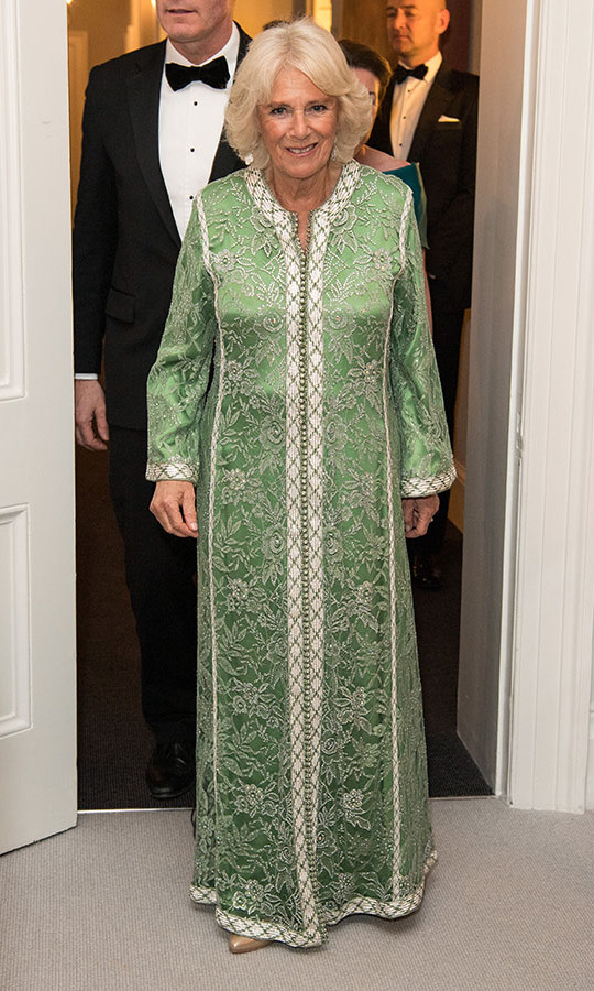 <a href=/tags/0/camilla-parker-bowles><strong>Duchess Camilla</strong></a> joined <a href=/tags/0/prince-charles><strong>Prince Charles</strong></a> at a dinner to mark St. Patrick's Day and to celebrate UK-Irish relations on March 6, 2019 in London. She was dressed for the occasion in a green and white maxi gown decorated with opulent floral embroidery. 