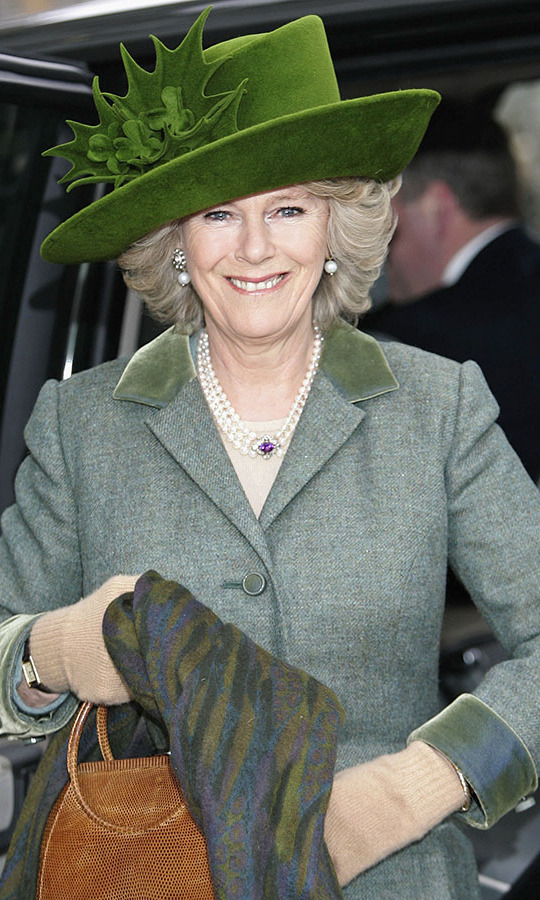 Green for good luck! The Duchess of Cornwall sported a St. Patrick's Day-themed <a href=/tags/0/philip-treacy><strong>Philip Treacy</strong></a> hat and coordinating green suit to the Cheltenham Races on March 17, 2006.