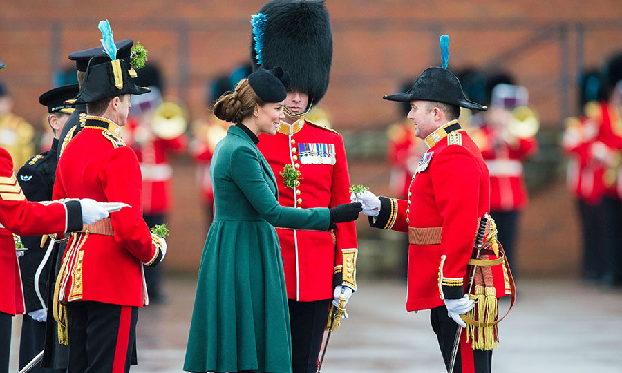 In keeping with tradition, Kate handed out shamrocks during the Irish Guards' St. Patrick's Day parade at Mons Barracks on March 17, 2013 in Aldershot. She was dressed in a gorgeous green <a href=/tags/0/emilia-wickstead><strong>Emilia Wickstead</strong></a> coat for the occasion. It was the same one she wore the previous year!