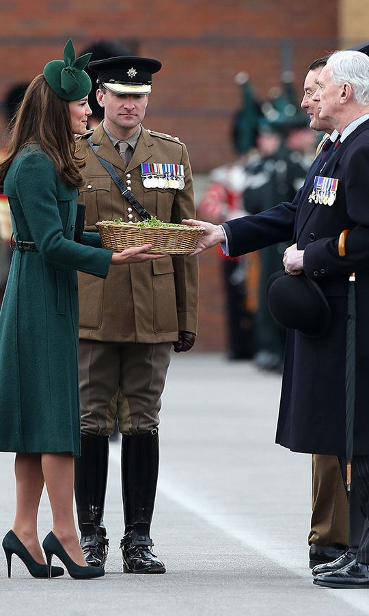 Clad in a regal green <a href=/tags/0/hobbs><strong>Hobbs</strong></a> coat, <strong>Gina Foster</strong> fascinator and heels, the Duchess of Cambridge joined Prince William on St. Patrick's Day 2014  to present the traditional sprigs of shamrock to the Irish Guards in Aldershot.