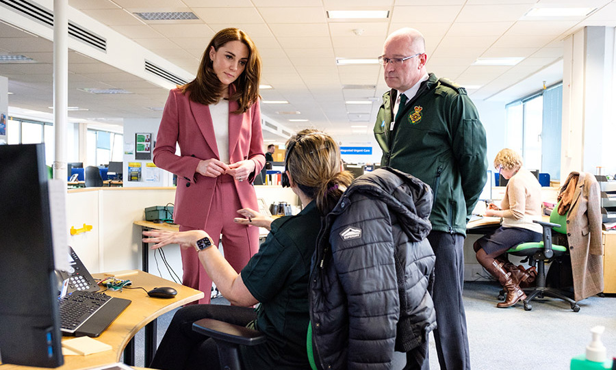 On a private visit to a NHS 111 control room in Croydon on March 19, <a href=/tags/0/kate-middleton><strong>Duchess Kate</strong></a>'s <a href=/tags/0/marks-and-spencer><strong>Marks & Spencer</strong></a> pink suit had a cheerful finish. She rounded out the look with simple accessories, a white top and silver pumps.