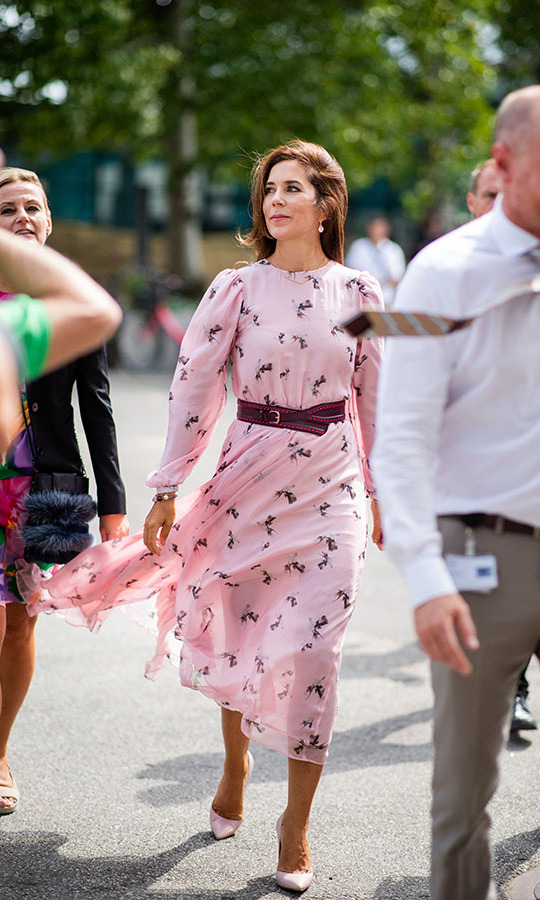 <a href=/tags/0/crown-princess-mary><strong>Crown Princess Mary</strong></a> looked beautiful at the Copenhagen Fashion Week Spring/Summer 2019 shows in a romantic printed pink dress with maroon belt and pastel pink heels. 