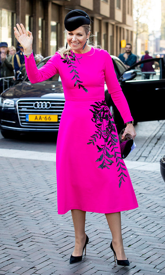What a vivid colour! In 2019, <a href=/tags/0/queen-maxima><strong>Queen Máxima</strong></a> turned heads in a shocking pink dress, embellished with glittering floral designs. The look was stopped with a dramatic black fascinator, dangling earrings, clutch and pumps. She stepped out to the National Institute for Budget Information (Nibud) in Utrecht.