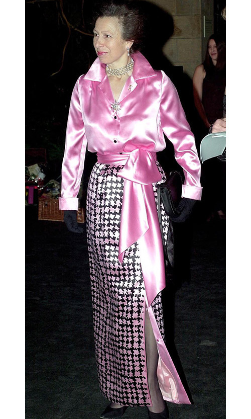 <a href=/tags/0/princess-anne><strong>Princess Anne</strong></a> made a bold fashion statement in a silky bubblegum pink blouse with tie belt and pink-and-black houndstooth skirt (plus matching lipstick!) at the Save the Children Festival of Trees and the Natural History Museum in 2001.