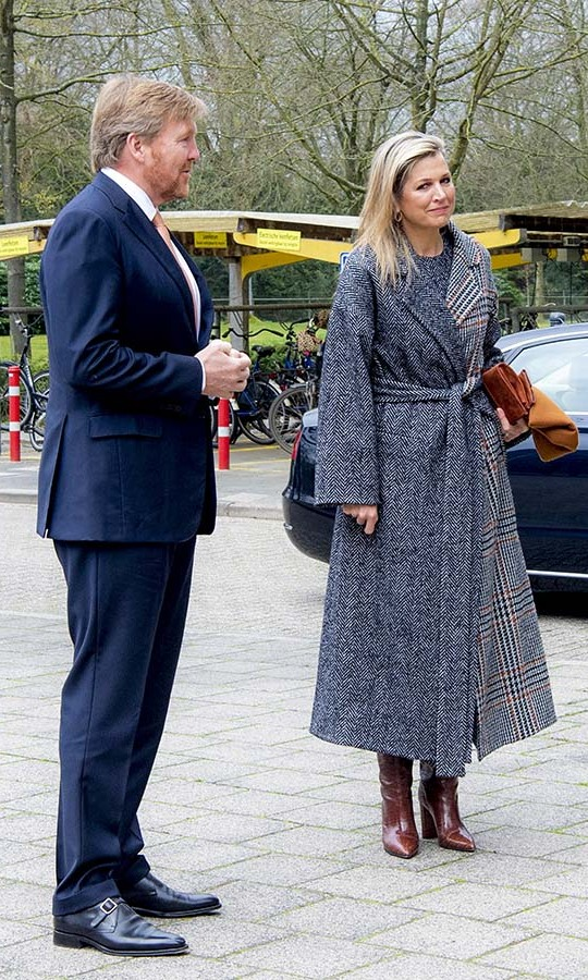 <a href=/tags/0/queen-maxima><strong>Queen Máxima</strong></a> made a style statement on April 3 in a split wrap jacket, featuring a grey tweed side and a red and grey plaid one! She accessorized with a deep orange clutch and tall red-brown boots. 