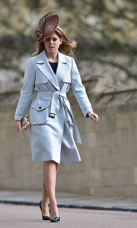 Princess Beatrice turned heads at Easter Sunday church service at St. George's Chapel in 2016 in a belted off-white trench coat, black pumps and a dramatically tipped fascinator.