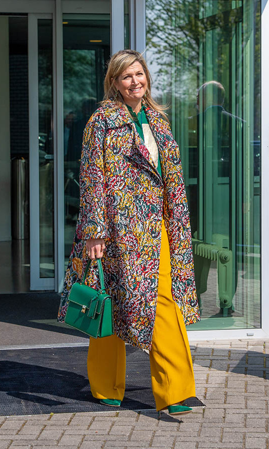 On April 16, <a href=/tags/0/queen-maxima><strong>Queen Máxima</strong></a> of the Netherlands made a colourful impression in a multicoloured coat, mustard trousers and a green blouse, bag and heels when she visited Demcon, a technology company producing medical machines, in Enschede.