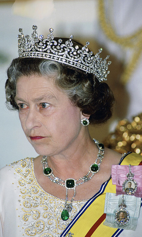 Her Majesty donned the awe-inspiring The Girls of Great Britain and Ireland Tiara with dazzling queen studs and a matching statement necklace to an evening engagement in Singapore, during her royal tour of Malaysia in 1989. 