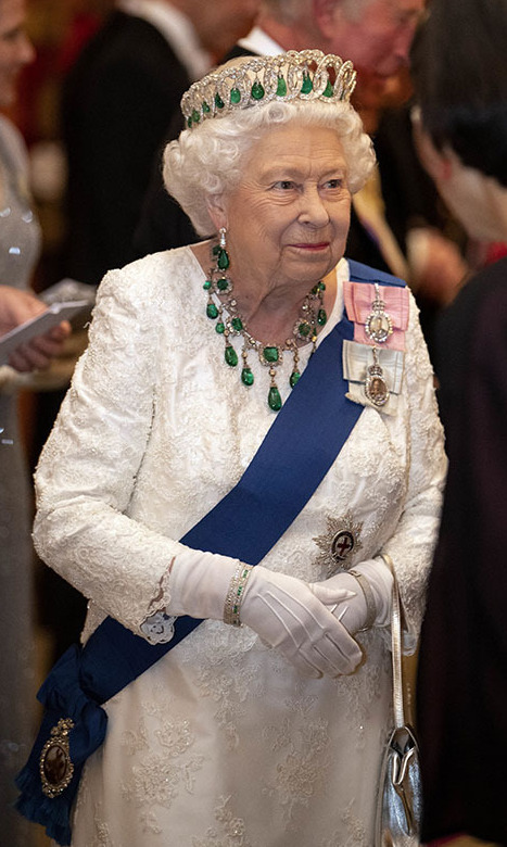 At the Diplomatic Corps reception at Buckingham Palace in 2019, the Queen debuted a breathtaking green necklace featuring square-cut emeralds surrounded by diamonds and accented with emerald drops. 