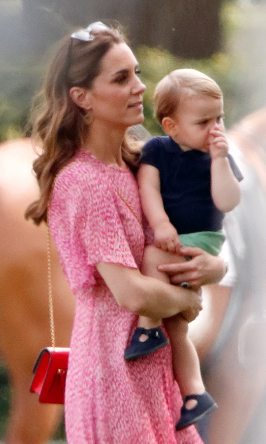 Royal watchers were thrilled when Kate brought Louis, George and Charlotte to watch their dad play polo against uncle <strong><a href=/tags/0/prince-harry>Harry</a></strong> in July 2019! We couldn't help but coo at seeing the one-year-old sucking his thumb while the Duchess of Cambridge carried him across the Billingbear Polo Club grounds.