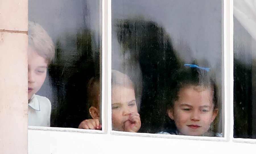Louis and his siblings were spotted looking out Buckingham Palace's windows just before the parade started. George looked pretty amazed by how many people were outside! 