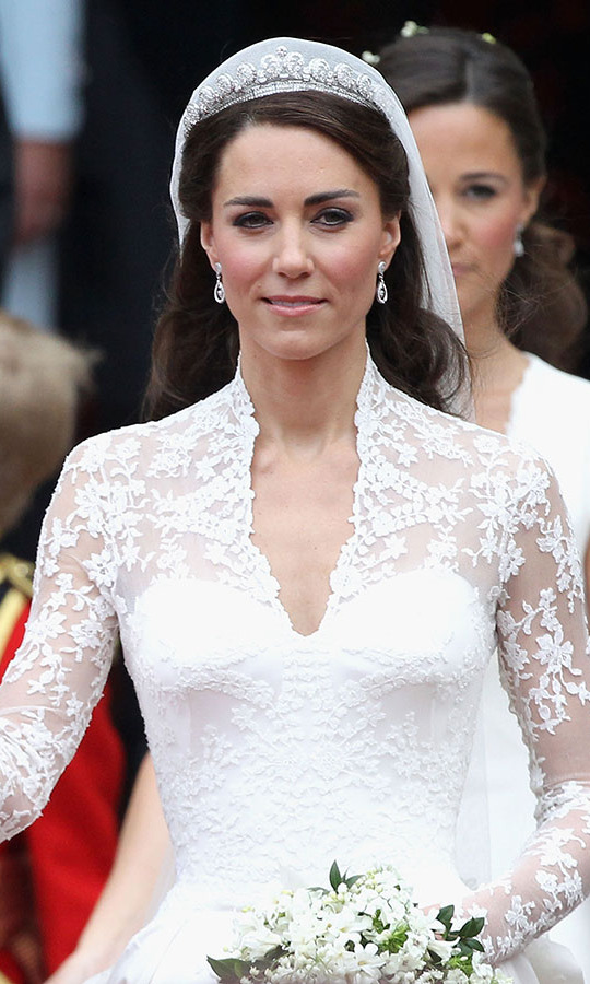 The 29-year-old bride looked resplendent in a platinum-and-diamond Cartier halo tiara, which was lent by the Queen. The dazzling piece was crafted in 1936 and given to then-Princess Elizabeth for her 18th birthday, by the <a href=/tags/0/queen-mother><strong>Queen Mother</strong></a>.