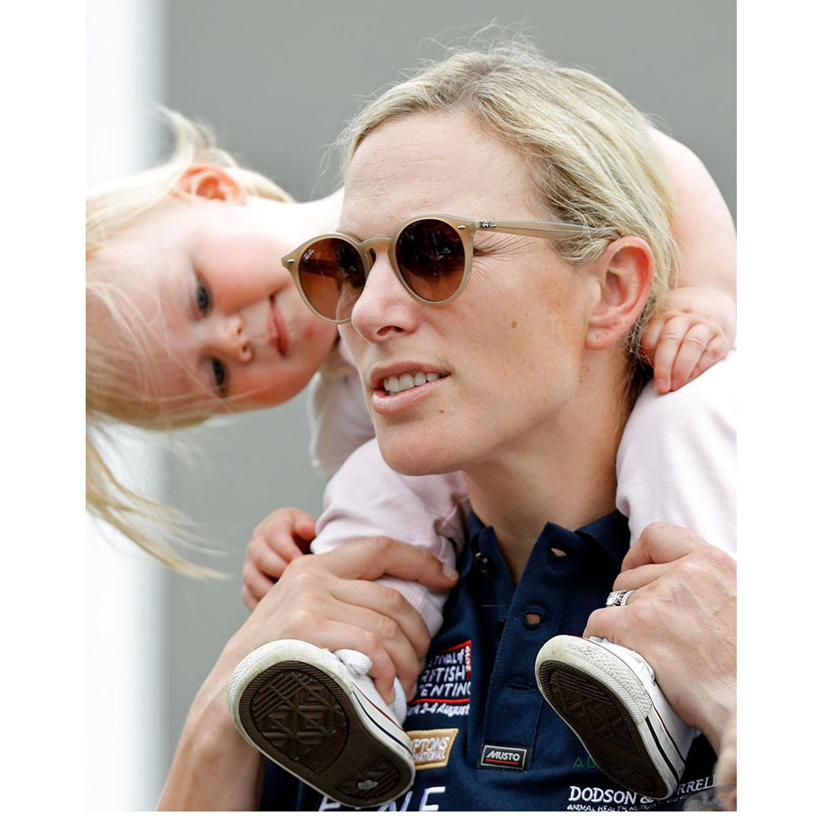 Lena appeared to be quite interested in her mother as she was carried on her shoulders. Maybe she wanted to try on her sunglasses?