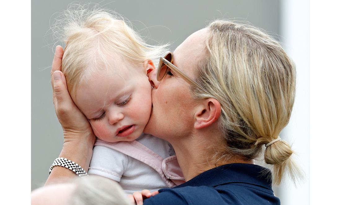 Zara affectionately kissed her young daughter when they were enjoying a day out in Stroud at the 2019 Festival of British Eventing. 
