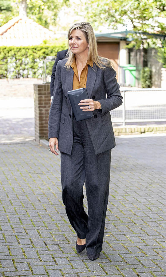 <a href=/tags/0/queen-maxima><strong>Queen Maxima</strong></a> of the Netherlands looked polished in a grey suit with mustard-coloured blouse when she visited the funeral centre Engelen & Spoor on July 2 to discuss the impact of COVID-19 on the funeral sector. Her look was accessorized with black pumps and a large clutch.