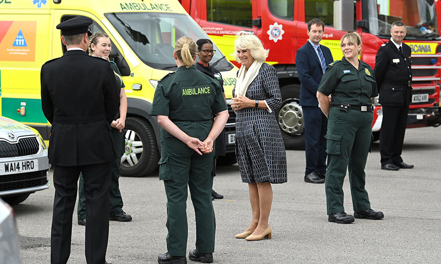 On July 6, <a href=/tags/0/camilla-parker-bowles><strong>Duchess Camilla</strong></a> met with firefighters, staff from Great Western Hospital and South Western Ambulance Service paramedics at Swindon Fire Station. She exuded elegance in a black-and-white geometric print dress accessorized with camel heels and a cream scarf.