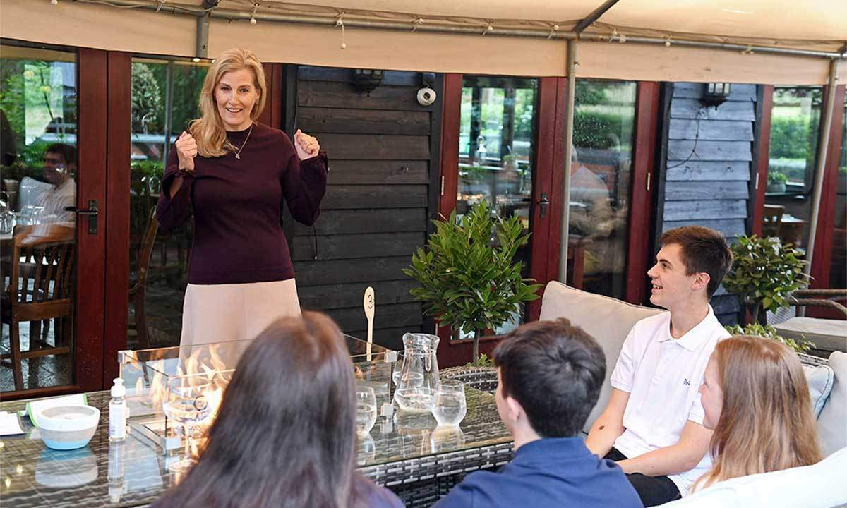 <a href=/tags/0/countess-of-wessex><strong>Sophie, Countess of Wessex</strong></a> looked elegant in a long-sleeved plum top, beige skirt and camel wedges during a visit to The Half Moon pub on July 8, 2020 in Windlesham. 