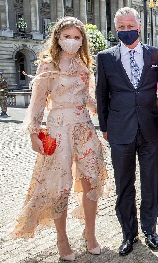 At the same event, <a href=/tags/0/princess-elisabeth><strong>Princess Elisabeth of Belgium</strong></a>, pictured with father King Philippe, stunned in a neutral dress with multicoloured paisley print and a coordinating non-medical mask. 