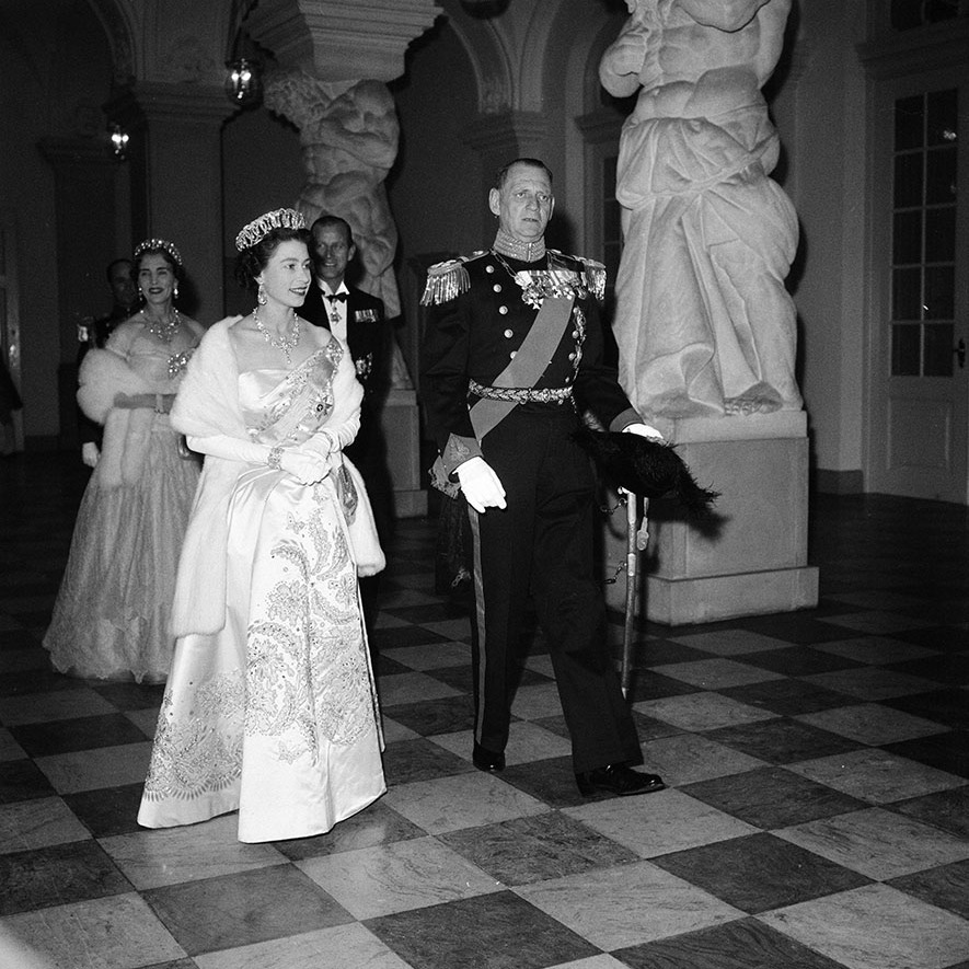 There was always something magical about Norman Hartnell's designs and that was evident in the Queen's bedazzled look when she and Prince Philip attended a state banquet at Christiansborg Palace in Denmark on May 21, 1957.