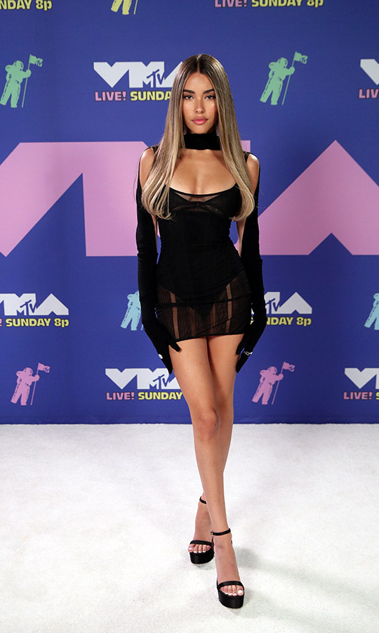 <strong>Madison Beer</strong> showed her sultry side in a sheer mini, bodysuit and long black gloves.