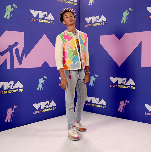 <strong>Jaden Smith</strong>'s multicoloured outfit should bring a smile to everyone thanks to the graphic jacket, pink sunglasses, printed T-shirt and statement sneakers.