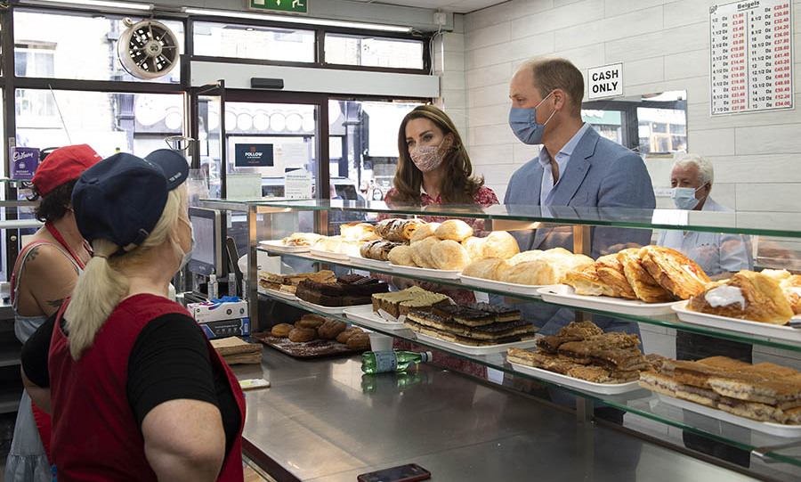 At Beigel Bake on Brick Lane, Duchess Kate and Prince William heard about the impact of the coronavirus on the iconic shop. The 24-hour bakery had to reduce its opening hours during the pandemic, but they assisted the community through delivery and donations.