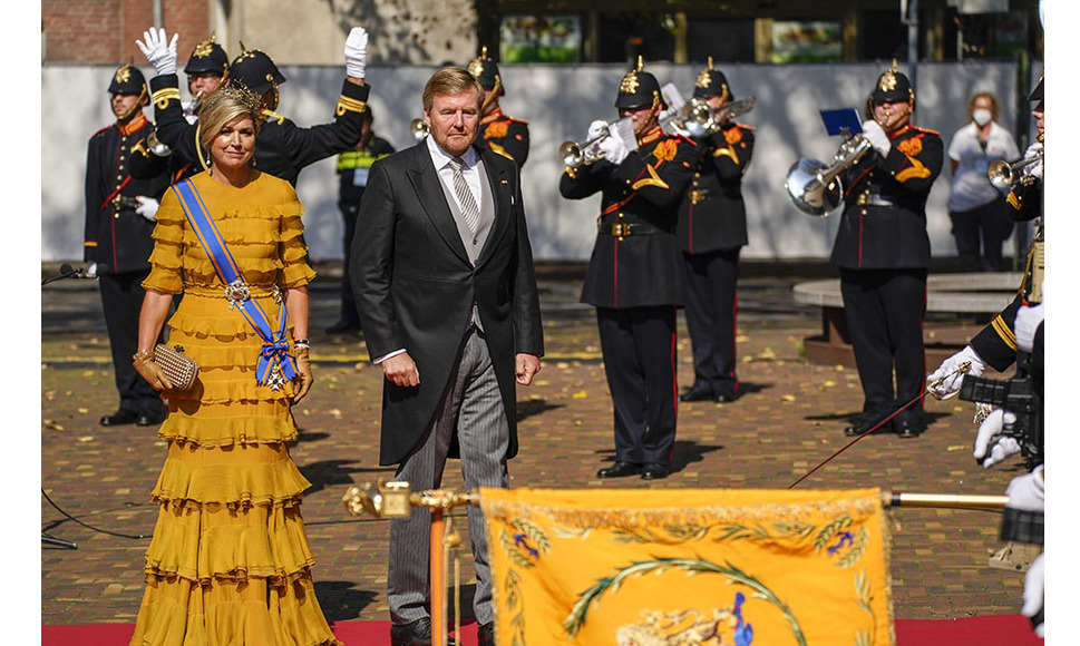 Also on Sept. 15, <a href=/tags/0/queen-maxima><strong>Queen Máxima</strong></a> and <a href=/tags/0/king-willem-alexander><strong>King Willem-Alexander</strong></a> participated in the king's address from the throne to members of the Senate and House of Representatives on Prinsjesdag (Budget Day). She rewore a mustard yellow <strong>Claes Iversen</strong> frilled gown from her closet. It was styled with a delicate gold fascinator and round clutch. 