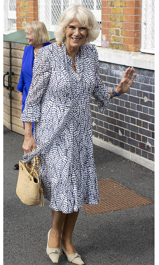 <a href=/tags/0/camilla-parker-bowles><strong>Duchess Camilla</strong></a> was all smiles on Sept. 8 in a white and blue spotted dress with scarf detail and light accessories at a royal engagement at Ivydale Primary School in London in honour of International Literacy Day.