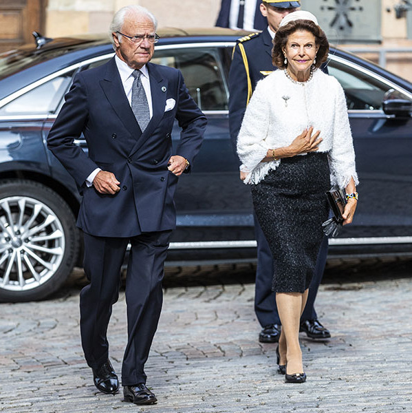 <a href=/tags/0/king-carl-gustaf><strong> King Carl Gustaf</strong></a> and <a href=/tags/0/queen-silvia><strong>Queen Silvia</strong></a> looked timelessly elegant with him in a dark navy suit and white shirt and her in a white tweed jacket, black skirt and pillbox hat to attend a church service at Stockholm Cathedral in connection with the opening of the Swedish Parliament for the fall session on Sept. 8.