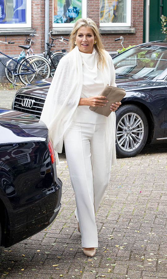 On Sept. 3, Máxima dazzled in an all-white outfit at the Thuis West Community Center in Rotterdam. She wore a statement brooch and coordinating earrings for a little more sparkle.