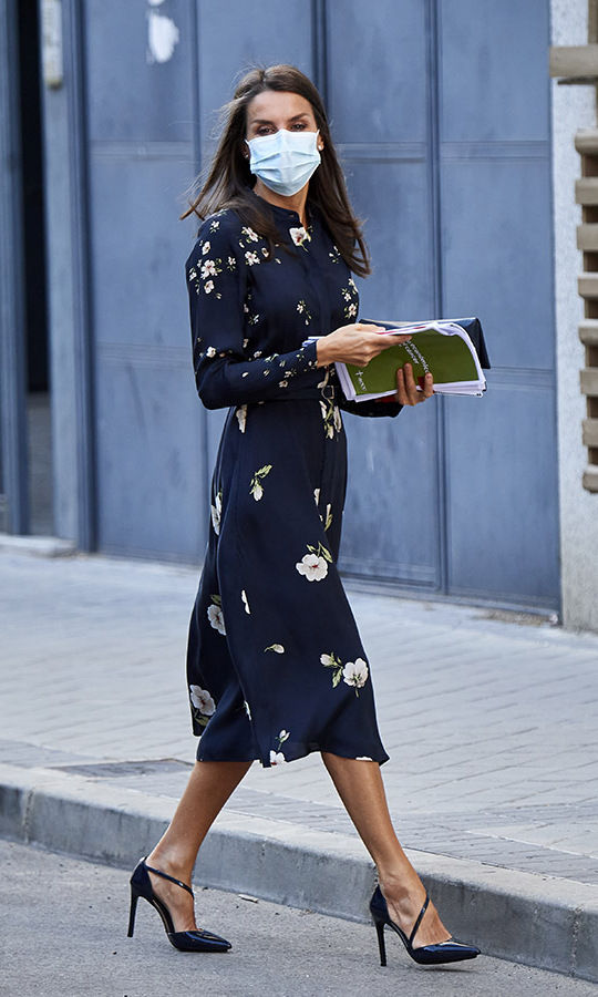 On the same day, Queen Letizia was out in Madrid to attend a meeting at the AECC (Spanish Association Against Cancer). She wore a long-sleeved navy dress with floral print by <a href=/tags/0/massimo-dutti><strong>Massimo Dutti</strong></a> and strappy heels.