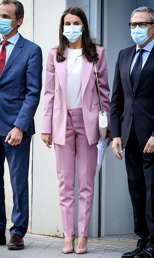 <a href=/tags/0/queen-letizia><strong>Queen Letizia</strong></a> recycled her pretty pink suit from <a href=/tags/0/hugo-boss>BOSS</strong></a> for a meeting at AECC (Spanish Association Against Cancer) on Sept. 24 in Madrid.