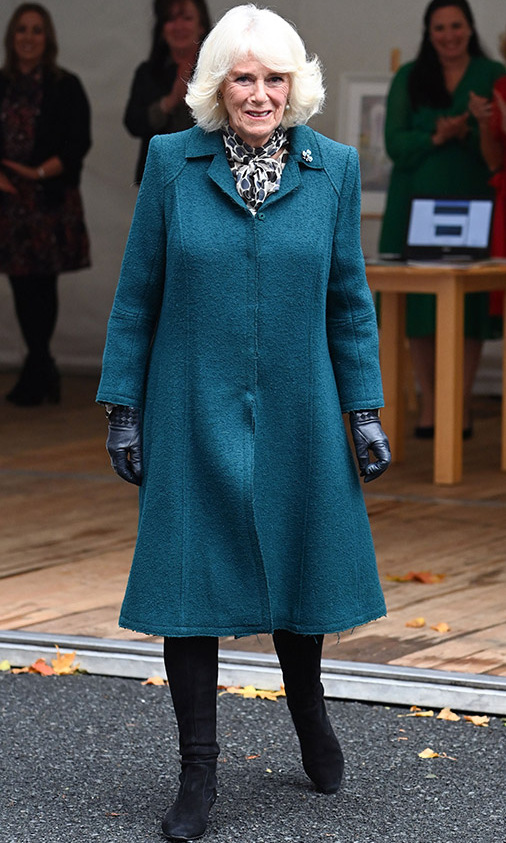 On Sept. 30, the <a href=/tags/0/camilla-parker-bowles><strong>Duchess of Cornwall</strong></a> kept warm in a forest green coat, tall black boots and matching gloves during a trip to Belfast.
