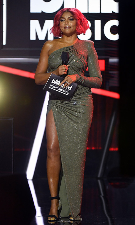 Presenter <a href=/tags/0/taraji-p-henson><strong>Taraji P. Henson</strong></a> made a statement in a one-sleeved <a href=/tags/0/Alexandre-Vauthier><strong>Alexandre Vauthier</strong></a> gown with high slit.